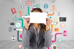 Composite image of businesswoman showing a card Stock Images