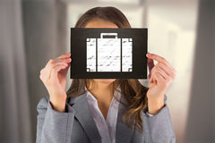 Composite image of businesswoman showing card Stock Photo