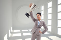 Composite image of businesswoman showing a cup Royalty Free Stock Photography