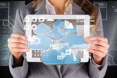 Composite image of businesswoman showing a tablet pc Royalty Free Stock Photos