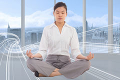 Composite image of businesswoman sitting in lotus pose Royalty Free Stock Image