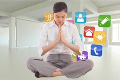 Composite image of businesswoman sitting in lotus pose Royalty Free Stock Images
