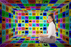 Composite image of businesswoman sitting in lotus pose Stock Photos