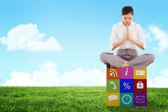 Composite image of businesswoman sitting in lotus pose Royalty Free Stock Photo