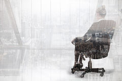 Composite image of businesswoman sitting on swivel chair in black suit Royalty Free Stock Photos