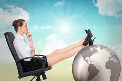 Composite image of businesswoman sitting on swivel chair with feet up Stock Photography