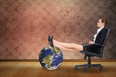 Composite image of businesswoman sitting on swivel chair with feet up Royalty Free Stock Photos