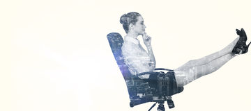 Composite image of businesswoman sitting on swivel chair with feet up Stock Images