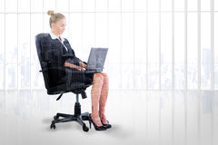 Composite image of businesswoman sitting on swivel chair with laptop Stock Photos