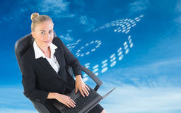 Composite image of businesswoman sitting on swivel chair with laptop Stock Images