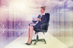 Composite image of businesswoman sitting on swivel chair with tablet Royalty Free Stock Image