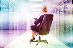 Composite image of businesswoman sitting on swivel chair with tablet Stock Image