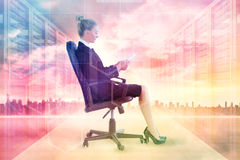 Composite image of businesswoman sitting on swivel chair with tablet Stock Photos