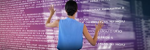Composite image of businesswoman in sleeveless clothing touching interface. Businesswoman in sleeveless clothing touching interface against pink and purple Royalty Free Stock Photography
