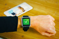 Composite image of businesswoman with smart watch on wrist Royalty Free Stock Photos
