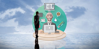 Composite image of businesswoman standing Stock Photo
