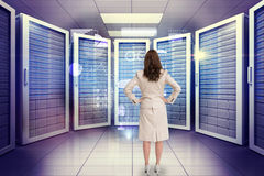 Composite image of businesswoman standing back to camera Royalty Free Stock Photo