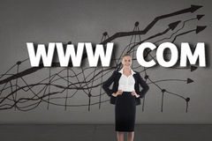 Composite image of businesswoman standing with hands on hips Royalty Free Stock Photos