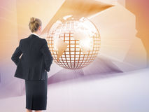 Composite image of businesswoman standing with hands on hips Stock Photo