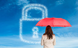 Composite image of businesswoman standing holding red umbrella Royalty Free Stock Images