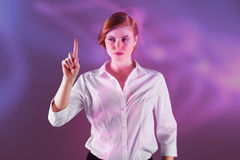 Composite image of businesswoman standing and pointing Royalty Free Stock Images