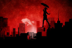Composite image of businesswoman stepping with umbrella Royalty Free Stock Photos