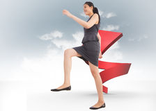 Composite image of businesswoman stepping up Royalty Free Stock Photo