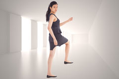 Composite image of businesswoman stepping up Stock Photo