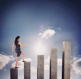 Composite image of businesswoman stepping up. Businesswoman stepping up against bar chart depicting growth Royalty Free Stock Photos