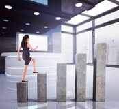Composite image of businesswoman stepping up. Businesswoman stepping up against bar chart depicting growth Stock Photography
