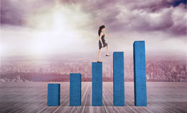 Composite image of businesswoman stepping up. Businesswoman stepping up against bar chart depicting growth Royalty Free Stock Photography