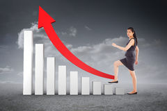 Composite image of businesswoman stepping up Stock Images