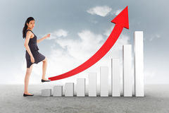 Composite image of businesswoman stepping up Royalty Free Stock Photography
