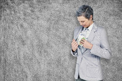 Composite image of businesswoman taking bribe Stock Image