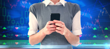 Composite image of businesswoman texting Stock Image