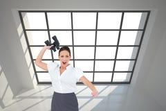 Composite image of businesswoman throwing binoculars away Royalty Free Stock Photos