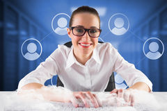Composite image of businesswoman typing on a keyboard Stock Photos