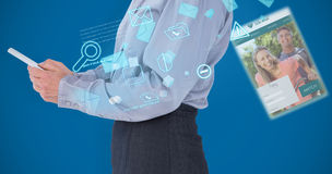 Composite image of businesswoman using her tablet. Businesswoman using her tablet against royal blue Stock Photography