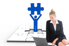 Composite image of businesswoman using laptop. Composite image of blonde businesswoman using laptop Stock Photo
