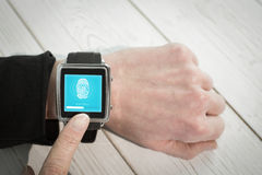 Composite image of businesswoman using a smart watch Stock Photo