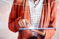 Composite image of businesswoman using a tablet Royalty Free Stock Photography