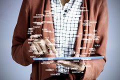 Composite image of businesswoman using a tablet Stock Photos