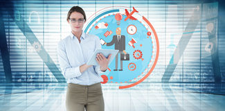 Composite image of businesswoman using tablet pc Stock Image