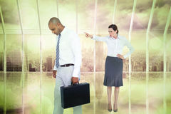 Composite image of businesswoman yelling at colleague Stock Image
