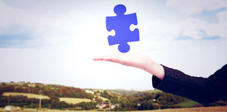 Composite image of businesswomans arm presenting Stock Image