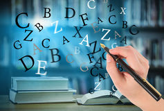 Composite image of businesswomans hand writing with fountain pen Royalty Free Stock Photos