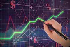 Composite image of businesswomans hand writing with fountain pen Stock Image