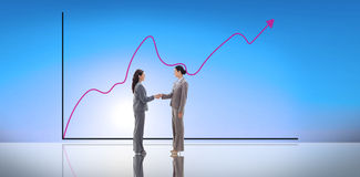 Composite image of businesswomen shaking hands Stock Images