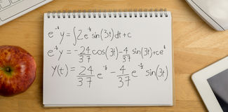 Composite image of calculations against black background stock photo
