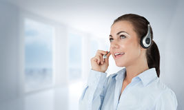 Composite image of call center agent looking upwards while talking Stock Photos